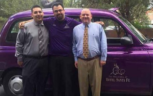 Hospitality and Tourism Student Jonathan Armijo, center, looks forward to moving up in the hospitality industry with the advanced degree options newly available through SFCC and NMSU. Jonathan is pictured with his coworkers at Hotel Santa Fe: Front Desk Manager Chris Armijo, left, and General Manager Corey Fidler.