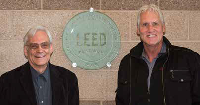 TATC Architect Allan Baer, left, and Wayne Lloyd enjoy the reception in honor of the LEED award on October 22.