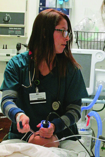 "Lynette Martinez, a May 2015 graduate of the Respiratory Care Program, was awarded ""Rookie of the Year"" by Presbyterian Hospital's Pulmonary Department"