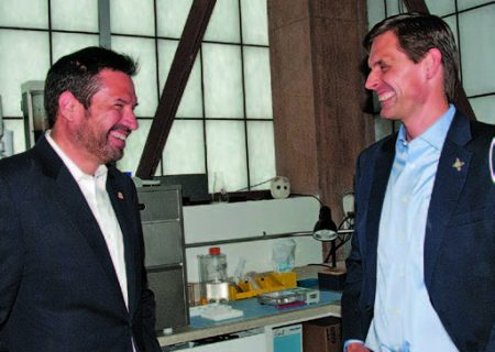 Santa Fe Mayor Javier Gonzales and U.S. Senator Martin Heinrich talk during the tour of the NTxBio analytics lab after the ribbon-cutting ceremony at the Trades and Advanced Technology Center. Copyright 2016 Anna C. Hansen