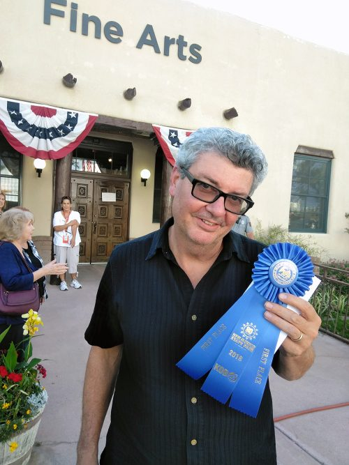 SFCC printmaking student Mike Kimball holds his First Place award from the State Fair