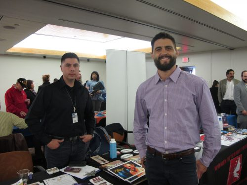 New Mexico's Mixed Martial Arts Fighter Carlos Condit (right) stops by to talk with Robert H. Romero, readjustment counseling tech at the Vet's Center in Santa Fe.