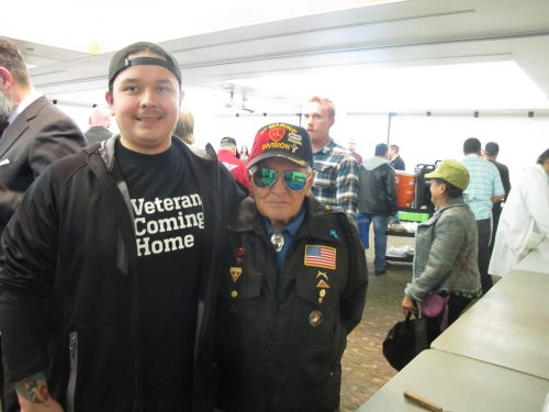 SFCC student veteran Sebastian Gonzales, 25, and José James Gallegos, who will be 85 later this month, were cited as the youngest and oldest veteran at the event and were asked to cut the celebration cake. Gallegos, who served in North Korea and Japan, has logged 14,800 volunteer hours to help veterans over the past 40 years. He makes frequent trips to visit veterans at the V.A. Hospital.