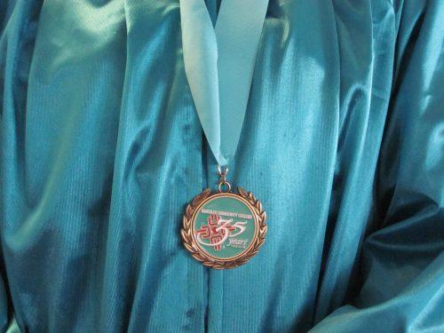 Graduates were given a 35th anniversary commemorative medallion.