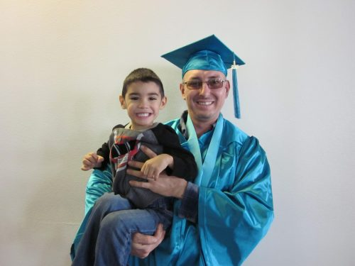 Thomas Peña celebrates graduation with his son. He received his AAS in Welding Technologies from Santa Fe Community College.