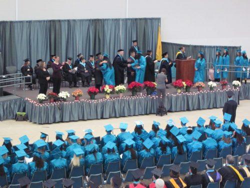 Graduates receive their diplomas at SFCC's fall graduation.