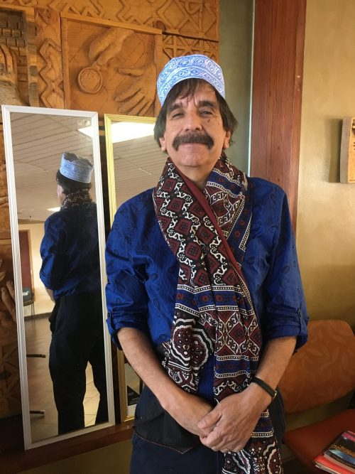 SFCC Faculty member Andrew Lovato, Ph.D., tried on a head covering and scarf at the event.