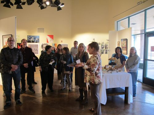Dean Bernadette Jacobs welcomes everyone to the Media Arts Student exhibition. She also led the group in a moment of silence in memory of Anita Quintana.  At far left is Peter Taussig, media arts chair.  Next to Jacobs is Linda Cassel, SFCC Art on Campus director.