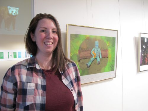 Michelle Carlson stands near her artwork,