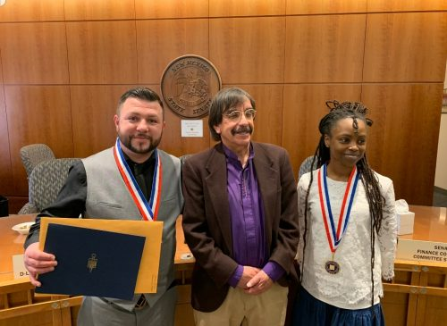Santa Fe Community College Academic All-Star Joshua Trujillo, Phi Theta Kappa advisor Andrew Lovato and Academic All Star Tintawi Kaigzabihner celebrate the students' accomplishment at the New Mexico state capitol.