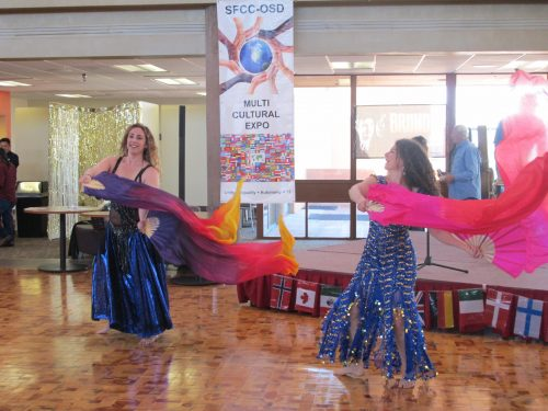 Sultanah Dancers perform a Turkish dance at the Diversity event.  Deborah Newberg, at right, teaches Middle Eastern dance at Santa Fe Community College.