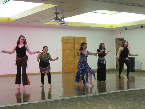 Belly dancing class performed a dance led by instructor Deborah Newberg, dressed in blue..