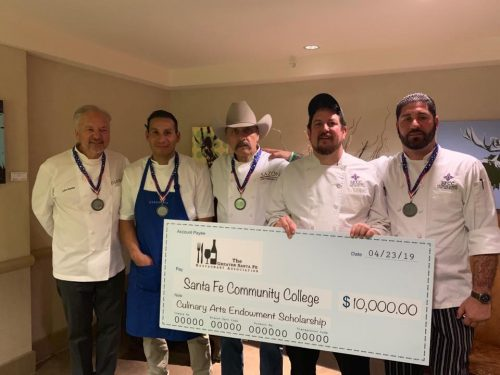 Left to right, John Sedlar, executive chef at Eloisa at Drury Hotel; Sllin Cruz, executive chef Geronimo Restaurant; Chef Fernando Olea, executive chef and owner at Sazon's Restaurant; Jerry Dankan SFCC Lead Culinary Arts Faculty and SFCC's Head of the East Wing Eatery and Culinary Instructor Patrick Mares accept the $10,000 scholarship check.