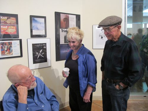 Photographer Joe Long talks with SFCC's Director of the Center of Book Arts and Printmaking Patricia Pearce and her husband Frank.