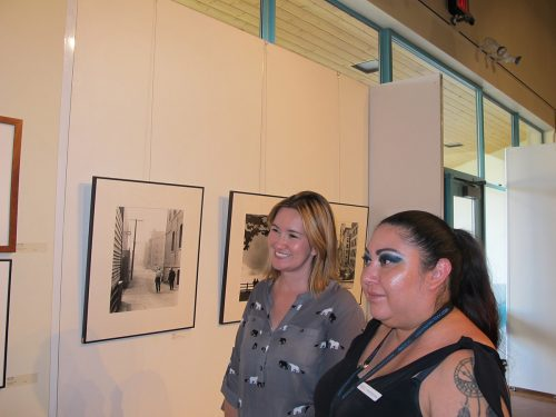From SFCC's Continuing Education office Maria Montoya and Paloma Trujillo-Anaya tour Joe Long's exhibit.  Long has taught with the CE program for 11 years.