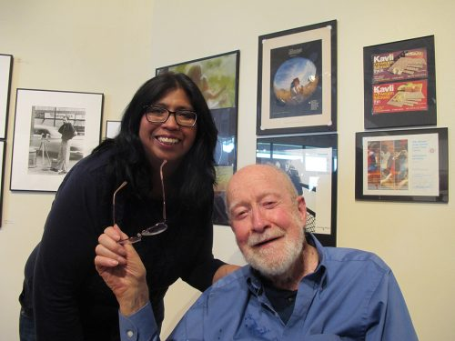 Santa Fe Community College Advisor Melba Ramos, who studied photography with Joe Long celebrates with him at the opening of his exhibition.