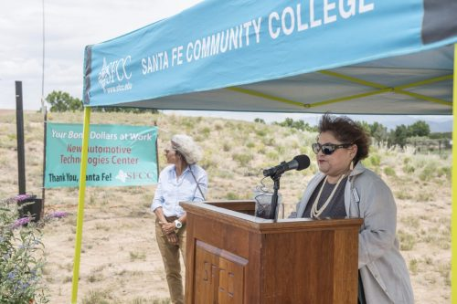Interim president Cecilia Cervantes, Ph.D. addresses the crowd as the chair of the governing board Linda Siegle looks on.