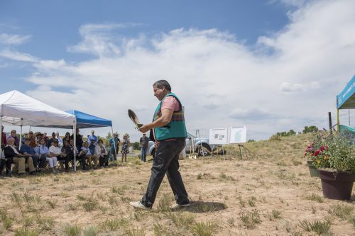 Robbie Gondara (Northern Cheyenne) gives a traditional Native American blessing on the ground to be broken.
