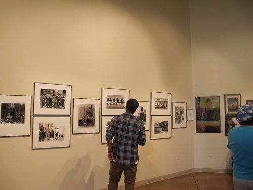 Students and community members viewed Joe Long's photo exhibition.