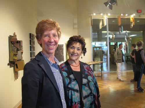 SFCC President Becky Rowley, Ph.D., and Director of SFCC Foundation Deborah Boldt enjoy the DWELL exhibition.