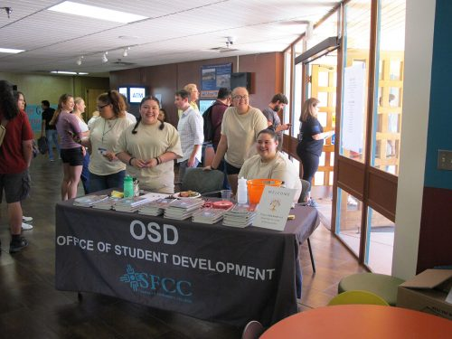 Students from the Office of Student Development greet faculty, staff and students who attended Fall Fest.