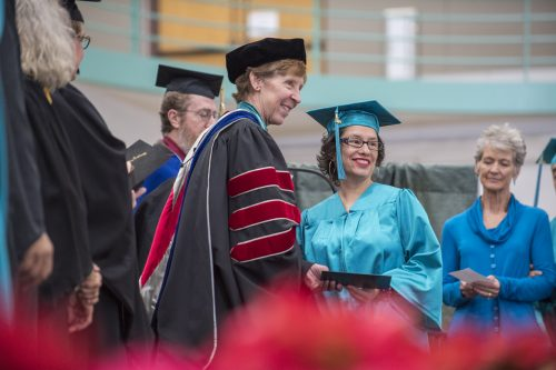 President Becky Rowley congratulates graduates at the Fall 2019 (Dec.) Commencement Ceremony. The Spring 2020 Commencement is a virtual commencement ceremony