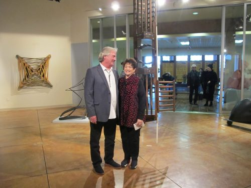 Artist Don & Deborah Boldt at the Feb. 14 opening standing in front of one of his pieces.