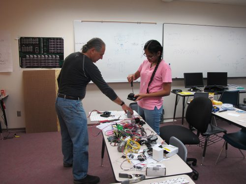 Mentor Paul Sakion, electrical engineer,  works with Neha Sukra, a Santa Fe High School student.