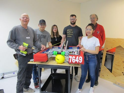 Left to right: Stu Ehrich, mentor (retired automechanic, fabricator); Juan de La Riva, Capital High student; Rosemary Moore, Santa Fe High student; Michael Frey, SFCC engineering student (a co-founder of SFCC Robotics Club); Mark DevOlder, mentor (retired Los Alamos National Lab engineer) and Amanda Kitrell, Santa Fe High student.