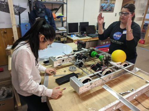 Sara Lanctot, right, (SFCC engineering student and co-founder of SFCC Robotics club) visits an FRC team in Los Alamos.