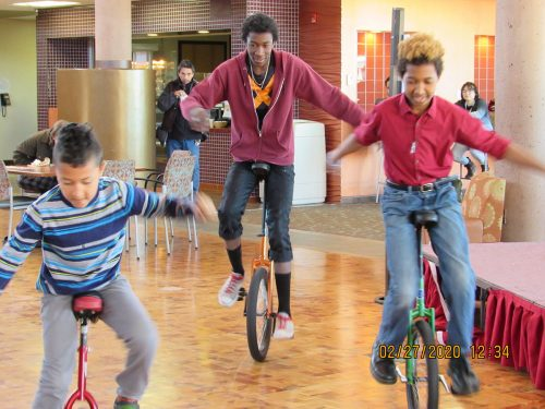 Unicyclists from Wise Fool: Pierce Anaya and SFCC students Magnificent Farrell and Gibralter Farrell.