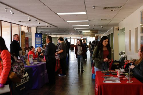 Many students stopped at several tables to talk to recruiters.
