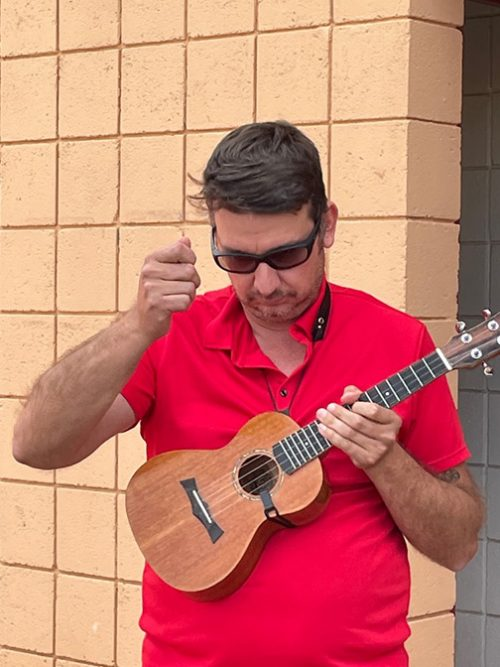 Todd Lovato warms up on the ukulele.  Photo by Roxanne Tapia.