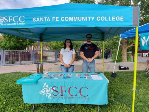 Daniela Gurule and Marcos Maez welcome concertgoers at SWAN park.